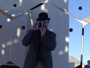 Self-portrait in one of the mirror segments at VERITAS (Very Energetic Radiation Imaging Telescope Array System), the gamma ray observatory in southern Arizona. The highest energy radiation creates showers of photons when it enters the atmosphere, which can be detected from the ground. [Credit: moi]